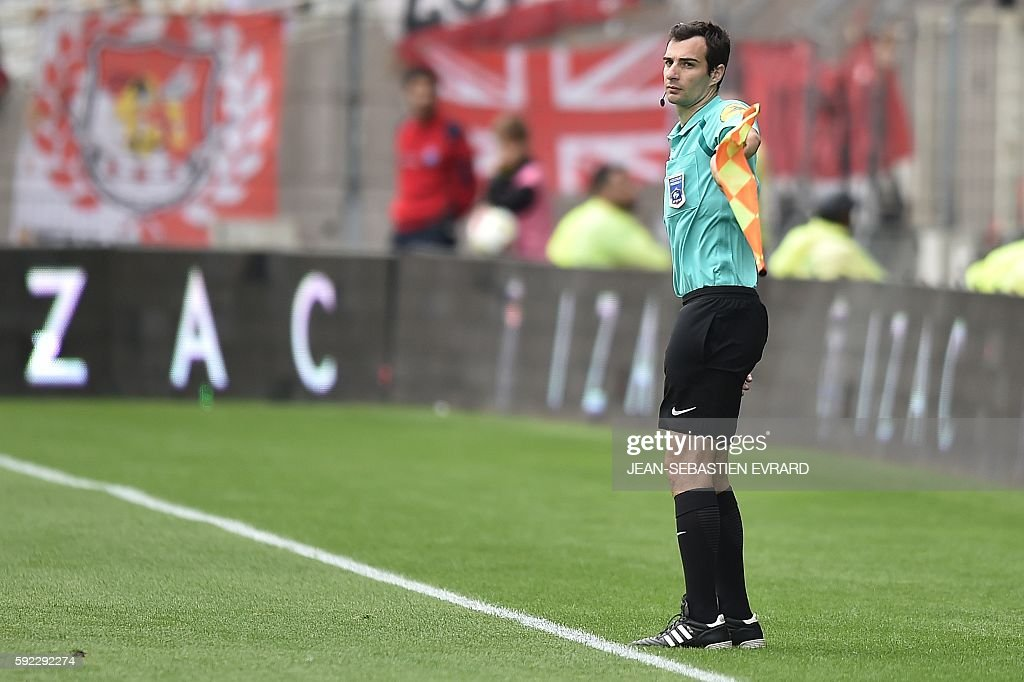 French assistant referee Julien Aube gestures during the French L1 football match between FC Nantes and AS Monaco on August 20 2016 at the Beaujoire...