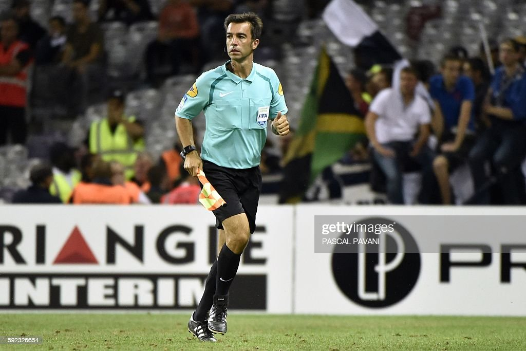 French assistant referee Mickael Annonier runs during the French L1 football match between Toulouse and Bordeaux on August 20 2016 at the Municipal...