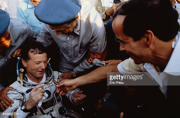 French astronaut JeanLoup Chretien is welcomed by fellow French astronaut Patrick Baudry who gives him a cigar just after the Soyuz T6 Russian space...