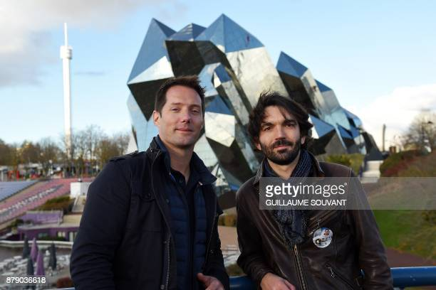 French astronaut Thomas Pesquet and film director PierreEmmanuel Le Goff pose on November 25 2017 in front of the Kinemax at the Futuroscope theme...