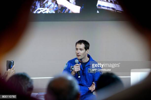 French astronaut Thomas Pesquet answers question at the European Space Agency pavillon on June 23 2017 at the International Paris Air Show in Le...