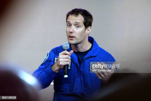 French astronaut Thomas Pesquet answers questions at the European Space Agency pavillon at the International Paris Air Show in Le Bourget near Paris...