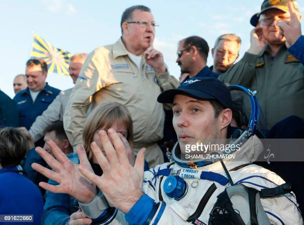 French astronaut Thomas Pesquet gestures after landing in a remote area outside the town of Dzhezkazgan Kazakhstan on June 2 2017 A Soyuz MS03...