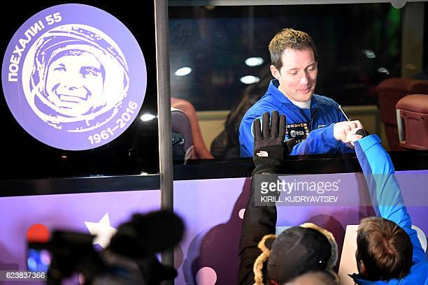 French astronaut Thomas Pesquet gestures from inside a bus as he leaves to board the Soyuz MS03 spacecraft at the Russianleased Baikonur cosmodrome...