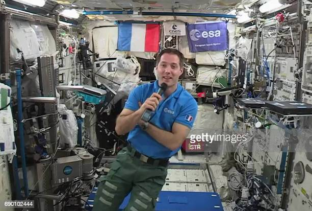 TOPSHOT French astronaut Thomas Pesquet gives an interview to AFP on May 30 aboard the International Space Station Pesquet will come back to Earth on...