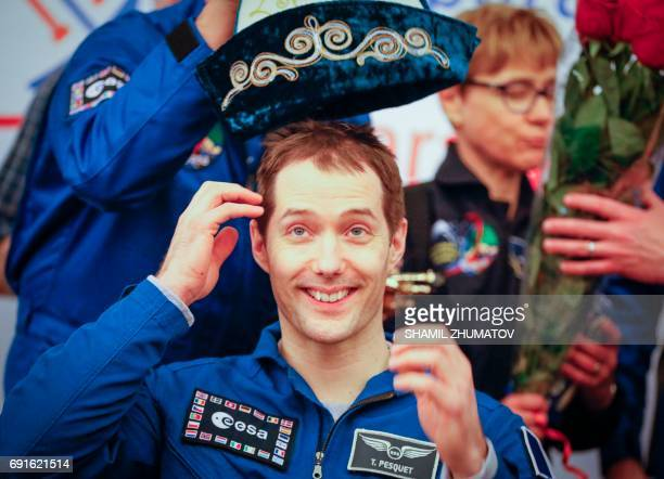 French astronaut Thomas Pesquet is presented with a traditional Kazakh hat during a press conference at the airport in Karaganda Kazakhstan on June 2...
