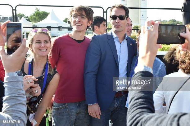 French astronaut Thomas Pesquet of European Space Agency poses for pictures as he arrives to attend the 30th congress of the Association of the Space...