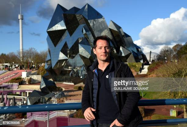 French astronaut Thomas Pesquet poses on November 25 2017 in front of the Kinemax at the Futuroscope theme park in ChasseneuilduPoitou Western France...