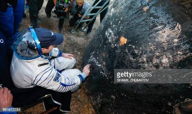 French astronaut Thomas Pesquet signs the Soyuz capsule after landing in a remote area outside the town of Dzhezkazgan Kazakhstan on June 2 2017 A...