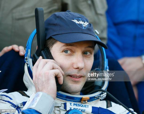 TOPSHOT French astronaut Thomas Pesquet speaks on a phone after landing in a remote area outside the town of Dzhezkazgan Kazakhstan on June 2 2017 A...