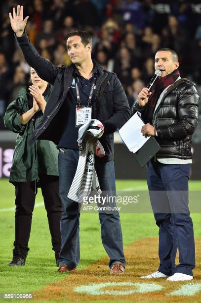 French astronaut Thomas Pesquet waves as he attends the French Top 14 rugby union match Stade Toulousain vs Clermont Auverge at the ErnestWallon...