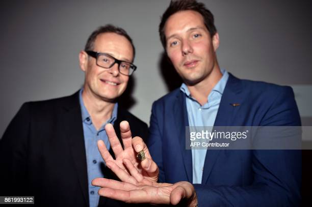 French astronauts Thomas Pesquet flanked by French astrophysicist at the Institute for Research in Astrophysics and Planetology Sylvestre Maurice...