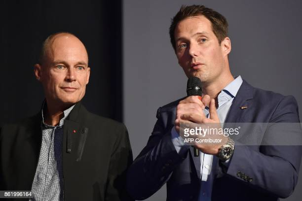 French astronauts Thomas Pesquet flanked by Swiss pilot and Chairman of the Solar Impulse sunpowered aircraft company Bertrand Piccard delivers a...