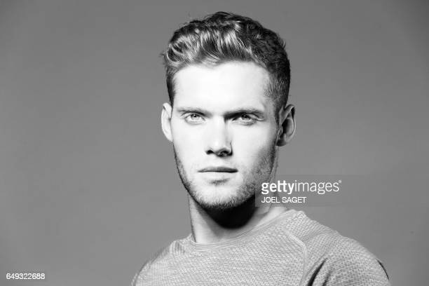 French athlete Kevin Mayer poses during a photo session in Paris on March 7 2017 / AFP PHOTO / JOEL SAGET / BLACK AND WHITE VERSION