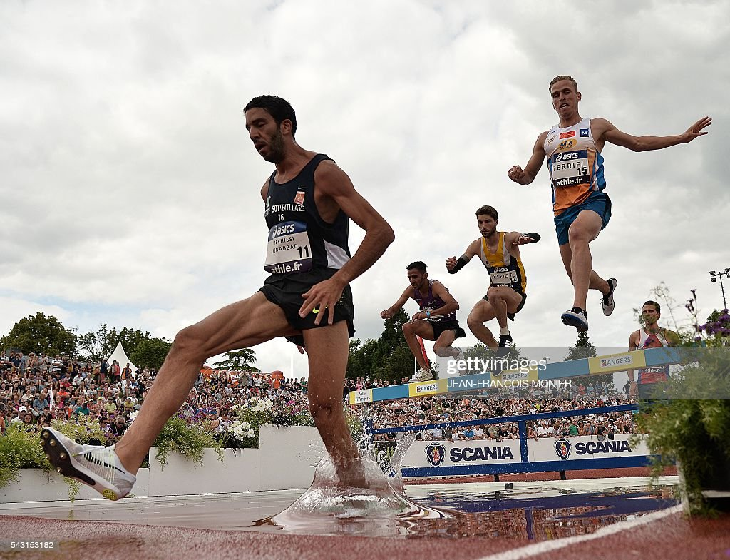 French athlete Mahiedine Mekhissi Benabbad (L) competes to win the men's 3000 Steeple final during the French Athletics Elite championships on June 26, 2016 at the Lac de Maine stadium in Angers, western France. / AFP / JEAN