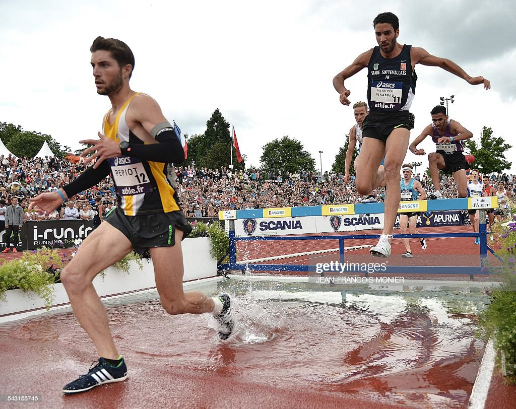 French athlete Mahiedine Mekhissi Benabbad (R) competes to win the men's 3000 Steeple final during the French Athletics Elite championships on June 26, 2016 at the Lac de Maine stadium in Angers, western France. / AFP / JEAN
