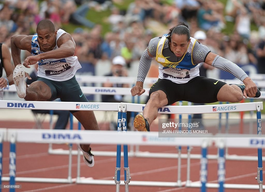 French athletes Pascal Martinot Lagarde (R) and Thomas Martinot Lagarde (L) compete during the men's 110 m hurdles series during the French Athletics Elite championships on June 26, 2016 at the Lac de Maine stadium in Angers, western France. / AFP / JEAN
