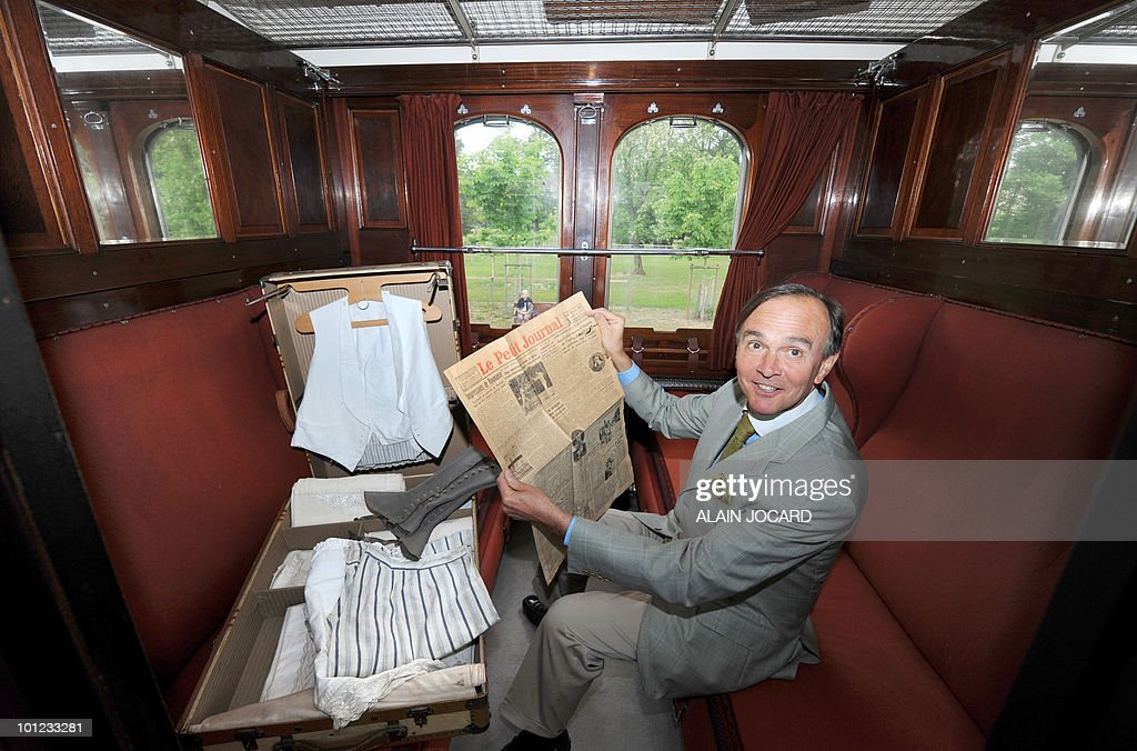 French auctioneer Philippe Rouillac poses on May 27, 2010 at La Ferte-Saint-Aubin, central France, in a train sleeping-car built in 1949, which was once part of the famous Orient-Express train. The car will auctionned off on June 5 and 6 with another one, a dining-car built in 1928. The Orient Express was the name of a long-distance passenger train originally operated by the Compagnie Internationale des Wagons-Lits between Paris and Istanbul. Although it was simply a normal international railway service, the name became synonymous with intrigue and luxury travel.
