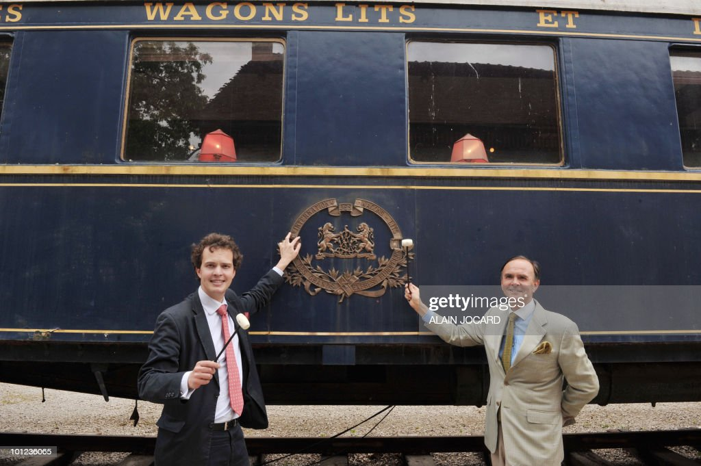 French auctioneers Philippe (R) and Aymeric Rouillac pose on May 27, 2010 at La Ferte-Saint-Aubin, central France, in front of a train dining-car built in 1928, which was once part of the famous Orient-Express train. The car will auctionned off with another one, a sleeping-car built in 1949, on June 5 and 6. The Orient Express was the name of a long-distance passenger train originally operated by the Compagnie Internationale des Wagons-Lits between Paris and Istanbul. Although it was simply a normal international railway service, the name became synonymous with intrigue and luxury travel.