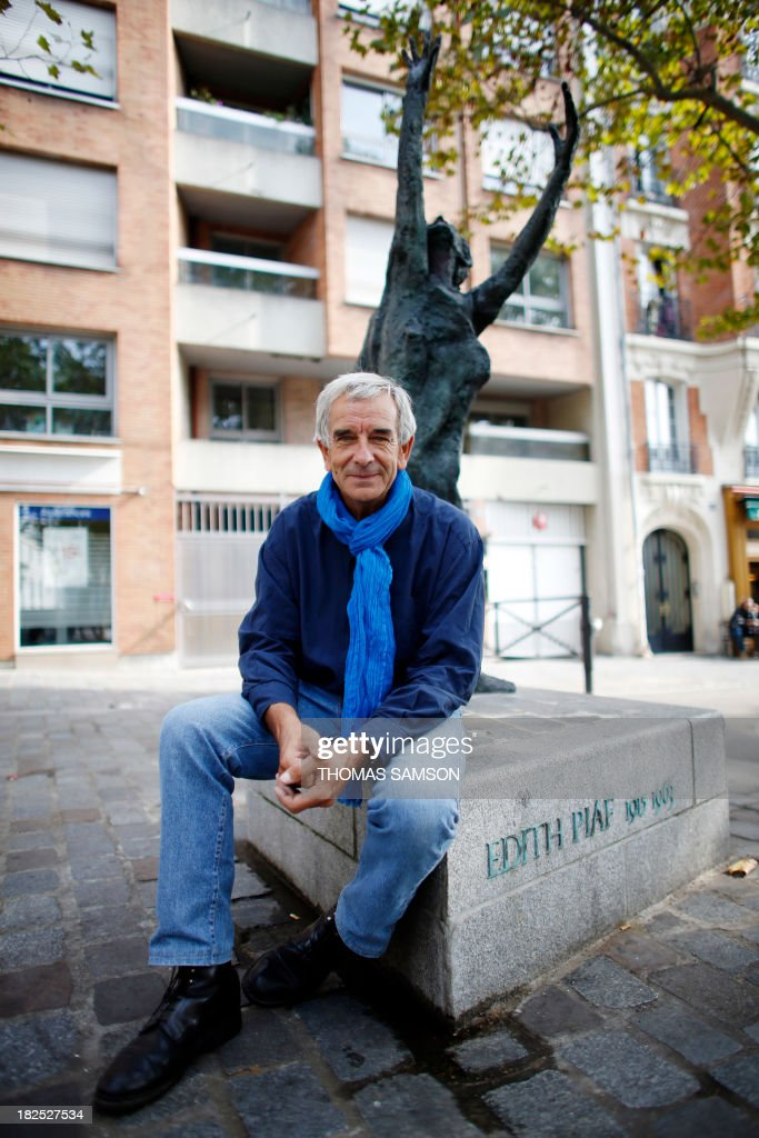 French author Robert Belleret, who wrote Edith Piaf's biography, poses in front of the singer's statue, on September 25, 2013, in Paris.