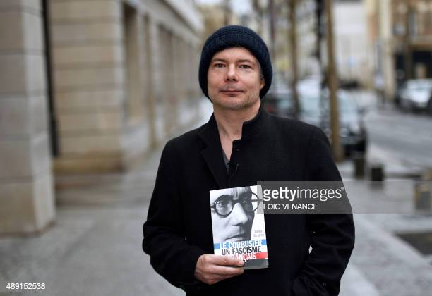 French author Xavier de Jarcy poses presenting his book 'Le Corbusier Un Fascisme Français' on April 3 2015 in BoulogneBillancourt outside Paris...