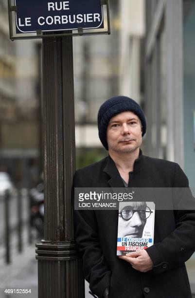 French author Xavier de Jarcy poses presenting his book 'Le Corbusier Un Fascisme Français' on April 3 2015 in BoulogneBillancourt outside Paris...