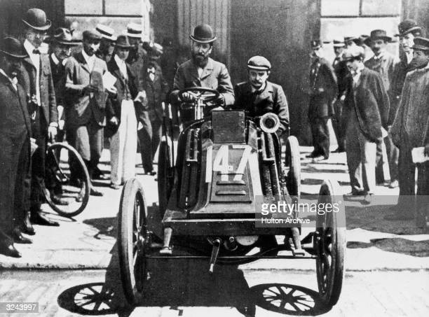 French auto manufacturer and race car driver Marcel Renault drives the 'cafe' race car in which he won the 1902 ParisVienna race