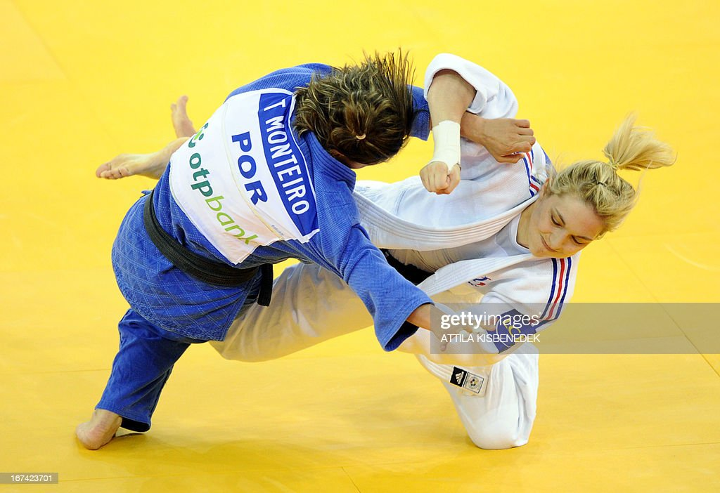 French Automne Pavia (white) fights with Portuguese Telma Monteiro (blue) during the Judo European Championships in 57kg category for women in Budapest on April 25, 2013.