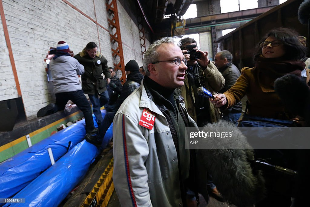 French automobile constructor PSA Peugeot Citroen trade union CGT representative Jean-Pierre Mercier speaks to the press in the PSA factory in Saint-Ouen after workers of the Aulnay's PSA plant entered the plant illegally through a hole in the wall on January 18, 2013, northern Paris. Aulnay's workers are on strike to protest against the closure of their factory. The company was rescued last October with a state guarantee of 7.0 billion euros ($9.0 billion) for its banking and credit arm, and is locked in a restructuring programme involving a plant closure and the loss of 8,000 jobs. SAMSON