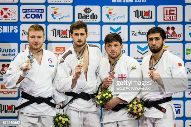 French Axel Clerget with silver Serbian Aleksandar Kukolj with gold Georgian Beka Gviniashvili and Russian Khusen Khalmurzaev both with bronze medals...