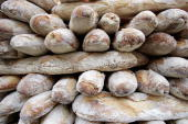 French baguettes are seen for sale at a stall during the Viva La France Show at Olympia on January 19 2006 in London England