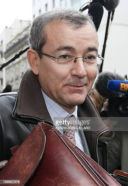 French bailiff Denis Calippe arrives at the French opposition UMP rightwing party headquarters on November 26 2012 in Paris Former prime minister...