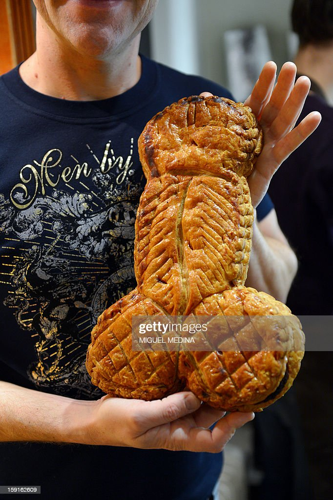 French baker Richard Legay shows a penis-shaped Ephiphany cake (galette des rois) on January 9, 2013 in the Marais district of Paris.