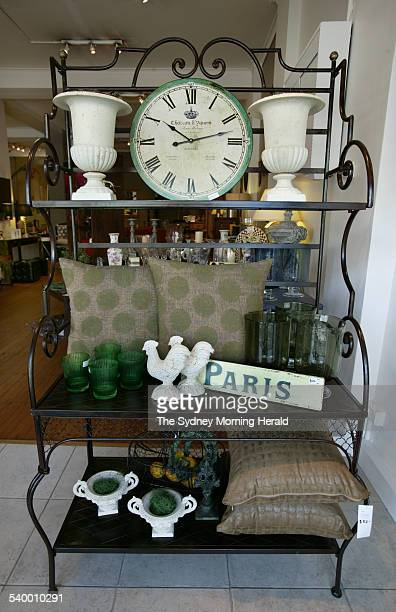 French Baker's Stand from Villa Crows Nest On the stand are castiron and glassware cushions and a French style wall clock 21 April 2006 SMH Picture...