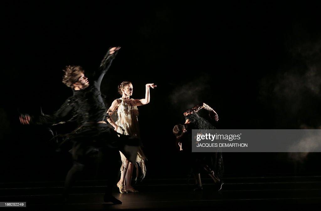 French ballet dancers Aurelie Dupont (C), Jeremie Belingard (L) and Nicolas Le Riche dance 'Darkness is hiding black horses' by Japanese choreographer Saburo Teshigawara at the Opera Garnier in Paris on October 29, 2013.