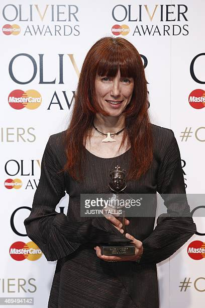 French ballett dancer Sylvie Guillem poses with a special award during the Lawrence Olivier Awards for theatre at the Royal Opera House in central...