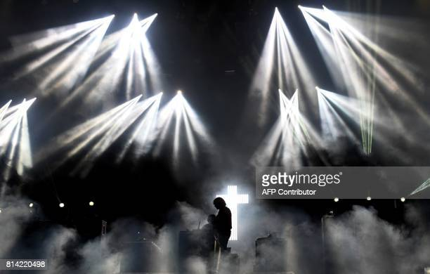 TOPSHOT French band Justice performs on July 13 2017 during the first day of the 26th edition of the 'Vieilles Charrues' music festival in...