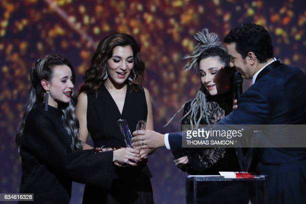 French band LEJ's members singer Elisa Paris French singer Lucie Lebrun and Juliette Saumagne react as they receive after receiving the best newcomer...