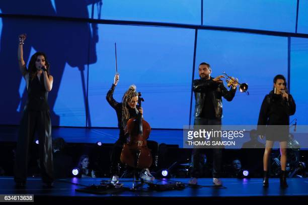 French band LEJ's members singer Lucie Lebrun singer Elisa Paris and violoncellist Juliette Saumagne perform on stage with FrenchLebanese composer...