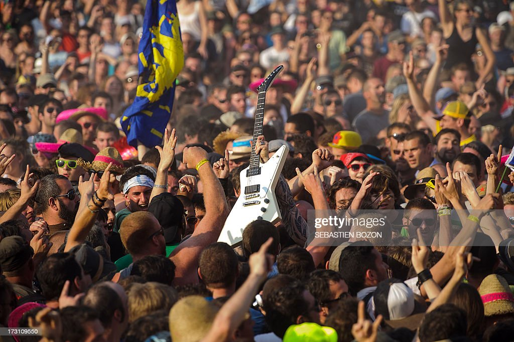 French band Mass Hysteria performs in the middle of the crowd during a concert on July 7, 2013 at the Eurockeennes music festival in the eastern France city of Belfort.