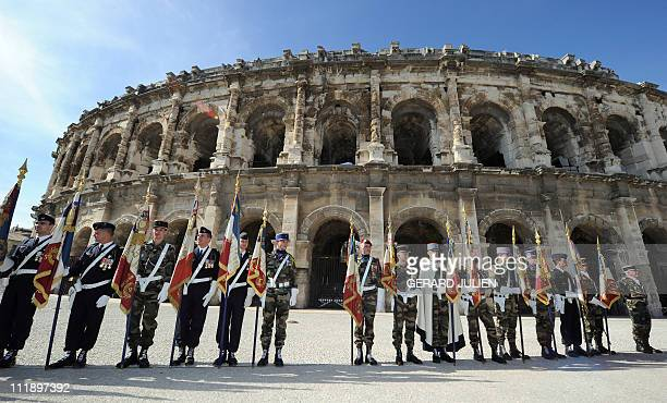 French bannerbearers taken part in a ceremony to mark the 20th anniversary of the Daguet military operation on April 6 2011 in front of the arenas of...