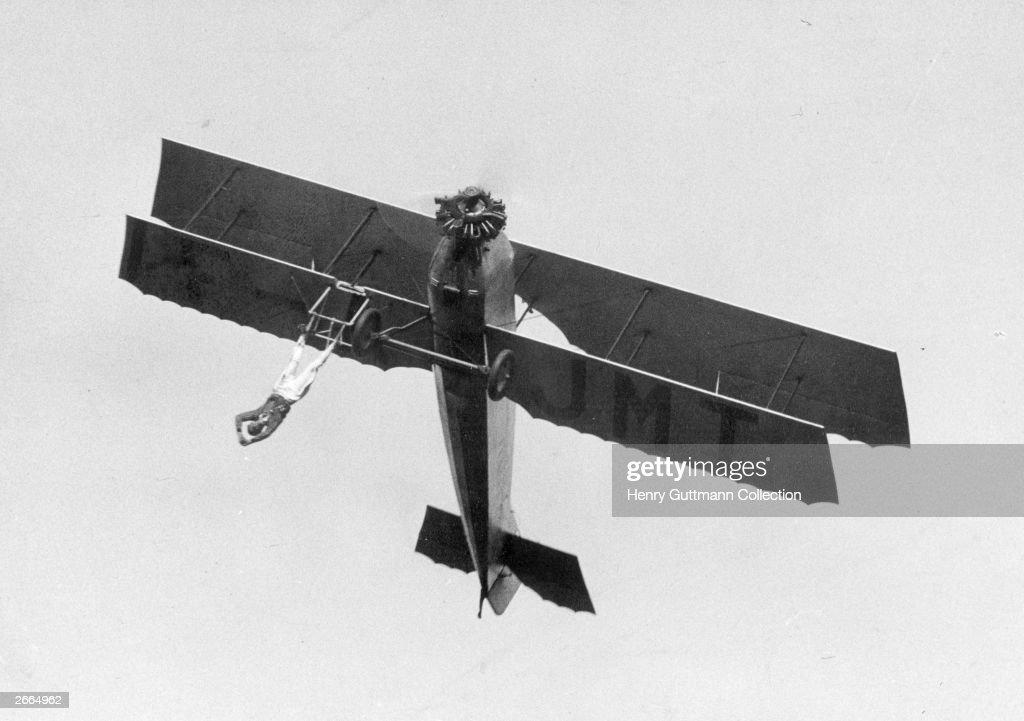 French barnstormer Vassard performing one of his death-defying stunts.
