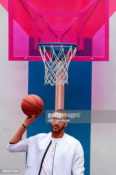 French basketball player and Utah Jazz's centre in the US Rudy Gobert plays basketball at the Duperre Pigalle playground in Paris on June 29 2017 /...