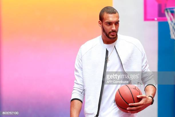 French basketball player and Utah Jazz's centre in the US Rudy Gobert holds a ball at the Duperre Pigalle playground in Paris on June 29 2017 / AFP...