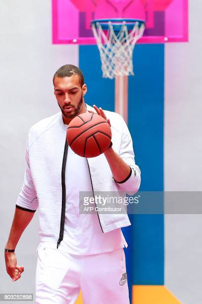 French basketball player and Utah Jazz's centre in the US Rudy Gobert plays at the Duperre Pigalle playground in Paris on June 29 2017 / AFP PHOTO /...