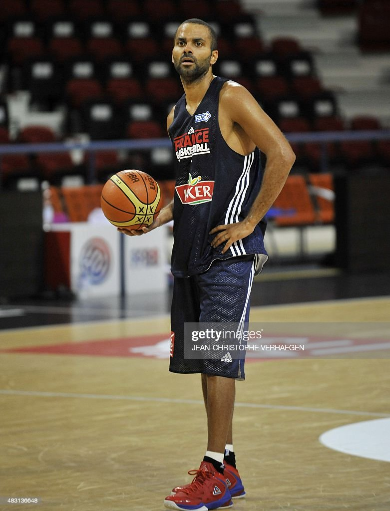 French basketball player Tony Parker looks on during a training