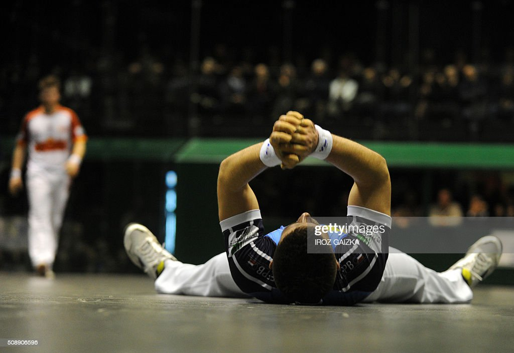 French Basque pelota champion Peio Larralde celebrates his victory after winning the final of the Hand Pelota French Championships, on February 7, 2016 in Bayonne. / AFP / IROZ GAIZKA