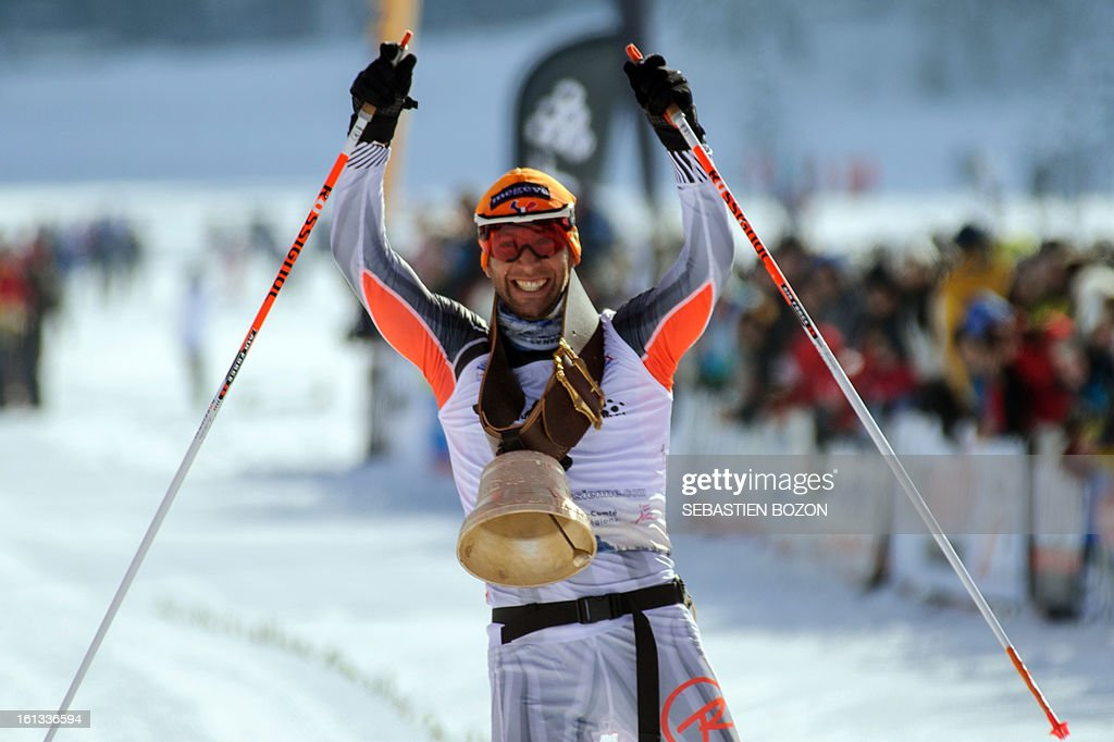French Benoit Chauvet celebrates as he crosses the finish line to win the Nordic Transjurassienne skiing race on February 10, 2013 in Lamoura, eastern France.