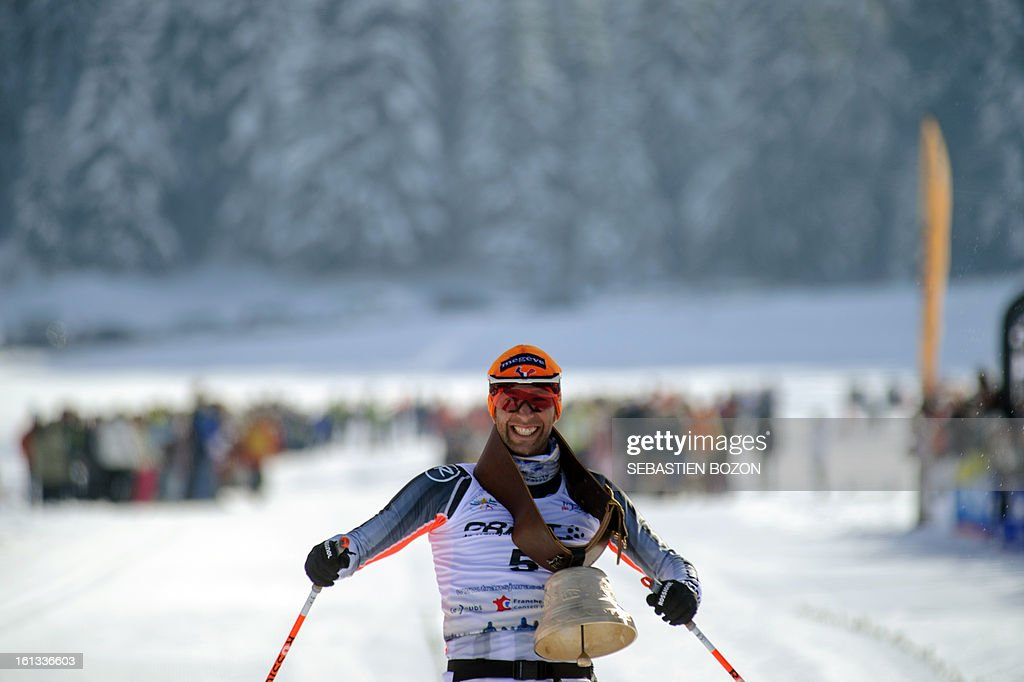 French Benoit Chauvet celebrates as he crosses the finish line to win the Nordic Transjurassienne skiing race on February 10, 2013 in Lamoura, eastern France. AFP PHOTO / SEBASTIEN BOZON