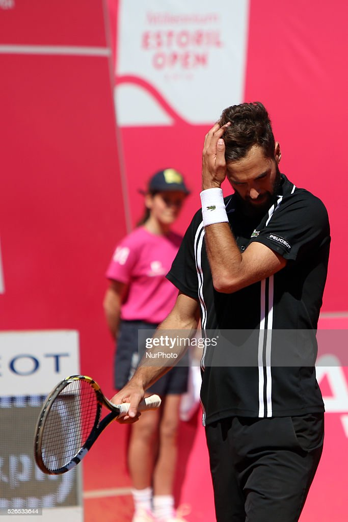 French Benoit Paire reacts during his game against Spanish Pablo Carreno Busta during the semifinal of the Millennium Estoril Open ATP 250 tennis tournament at the Clube de Tenis do Estoril in Portugal on April 27, 2016.